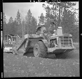 Heavy duty equipment operator, Nanaimo ; man working on an Allis-Chalmers 260 scraper ; man opera...