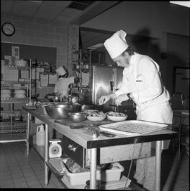BC Vocational School Cook Training Course ; student preparing salads ; student in background