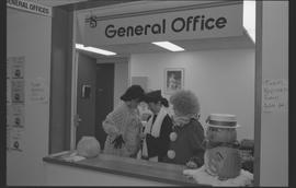 General Office staff dressed as a housewife (?), clown, and priest [9 of 11 photographs]