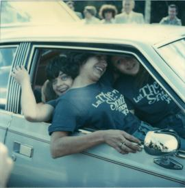 Student Rally 1984 ; three students piled into the front seats of a car