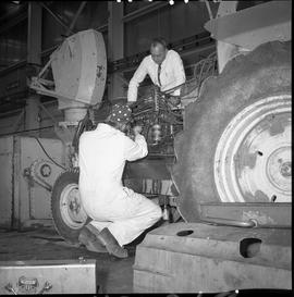 BCVS Heavy duty mechanic program ; a student working on a tractor engine ; instructor watching [1...