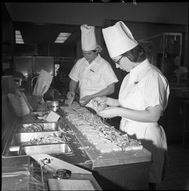 BC Vocational School Cook Training Course ; two students preparing sandwiches for the Food Traini...