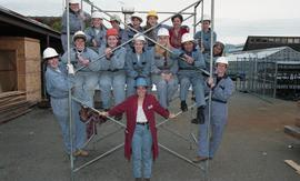 BCIT women in trades; plumbing, group shot of instructor (?) with students in uniforms and hard h...