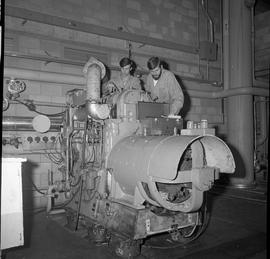 BC Vocational School Diesel Mechanic program ; two students repairing a large diesel engine [3 of 3]