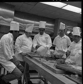 BC Vocational School Baking Course ; Mr. Buckley, cooking instructor, demonstrating to students [...