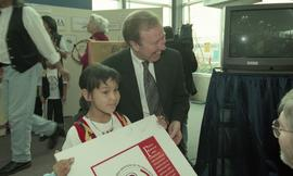 "BCIT open house '98, First Nations youth holding a poster that reads ""First Nations Programs..."