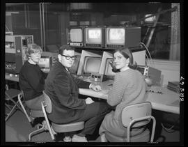 Man and women in editing booth