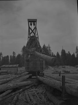 Log Loading, Nanaimo campus, 1967;  front view of a log loader carrying two logs