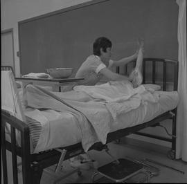 Practical nursing, Nanaimo, 1968; nurse washing a patient's arm [2 of 2]