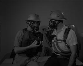 Mining, 1966; two men wearing gas masks and hard hats