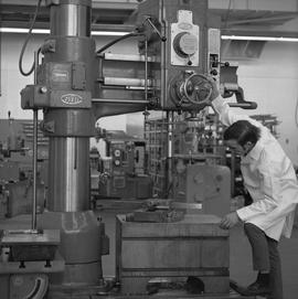 Mechanical technology, 1968; man in a lab coat using a large Asquith drill [1 of 3]