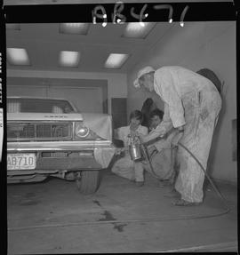 BC Vocational School image of Autobody program instructor and student repairing a vehicle in the ...