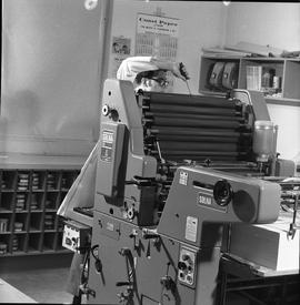 BCVS Graphic arts ; a man fixing a Solna 125 printing press