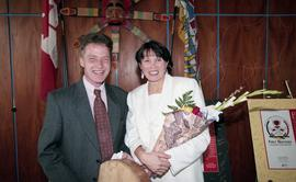 BCIT open house '98, First Nations woman holding a bouquet beside a man [2 of 2 photographs]