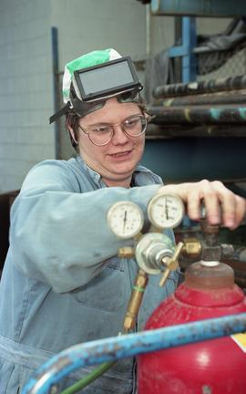 BCIT women in trades; welding, students in safety gear using a welding pressure regulator (?) ins...