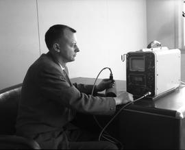 Instrumentation, 1964; man sitting at a desk using an ultrasonic flaw detector [4 of 4]