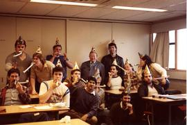 Aircraft Maintenance students with Instructor C. Gordon Peters; party hats, celebrating [2 of 2 p...
