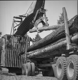 Logging, 1969; a log loader moving a log onto a trailer