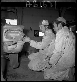 BC Vocational School image of Autobody program students working on a vehicle in the shop [2 of 8 ...