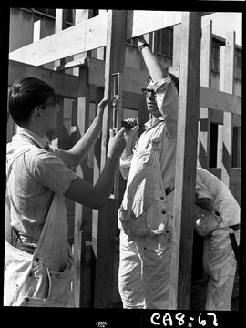 B.C. Vocational School image of Carpentry Trades students outside the Carpentry shop building a w...