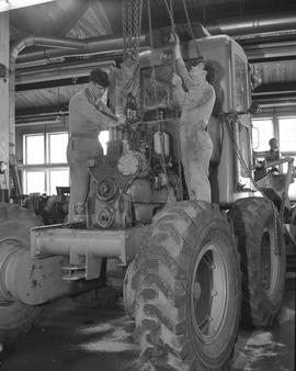 BCVS Heavy duty mechanic program ; two students working on a tractor engine