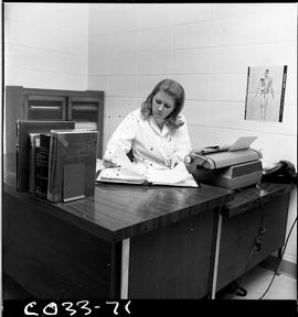 BC Vocational School Commercial Program; women sitting in an office at a desk with a typewriter r...