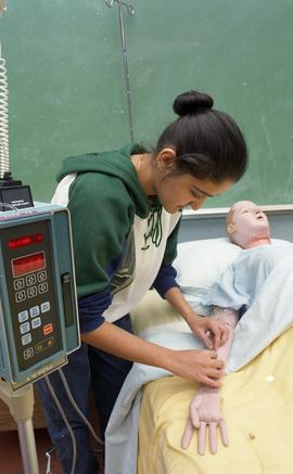 General Nursing, student with dummy patient in bed [2 of 8 photographs]