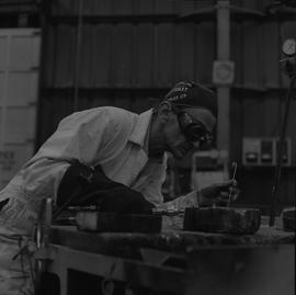 Welding, 1968; man wearing protective goggles welding [1 of 6]