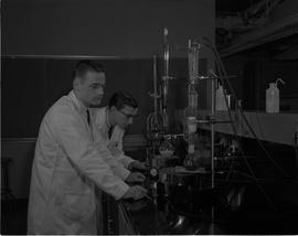 Food Processing Technology, 1966; two men in lab coats looking at liquids in beakers and test tubes