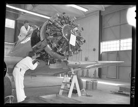 British Columbia Vocational School image of Aeronautics students working on an aircraft inside th...