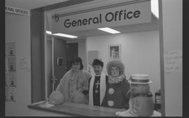General Office staff dressed as a housewife (?), clown, and priest [10 of 11 photographs]