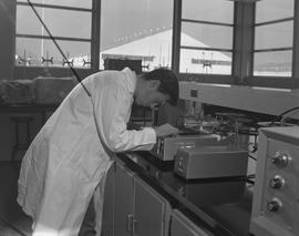 Food Processing Technology, 1966; man in a lab coat using food processing equipment ; other equip...
