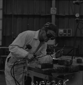Welding, 1968; man wearing protective goggles welding [5 of 6]