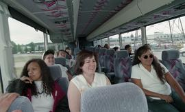 Pre-trade Aboriginal women; gas, students on a trip to see natural gas sitting in a bus together ...