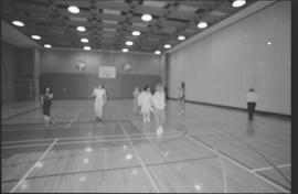 Staff (?) in costumes doing aerobics in a gymnasium [15 of 15 photographs]