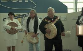 BCIT open house '98, First Nations peoples and elder on stage with instruments [1 of 2 photographs]