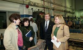 BCIT women in trades; steel fabrication, BCIT staff members and VIPs talking inside a shop [4 of ...