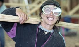 BCIT Women in Trades Training; carpentry, woman with eye protection, carrying wood [1 of 3 photog...