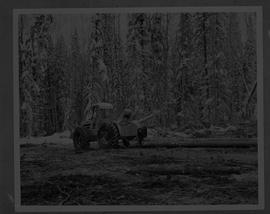BCIT Forestry; picture of a person working next to a skidder in a forest