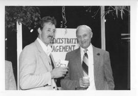 BCIT Alumni Association AGM 1988; two men holding drinks and posing for a photograph