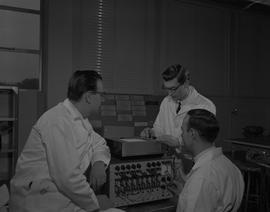 Instrumentation, 1966; three men in lab coats using instrumentation equipment to test a Bausch &a...