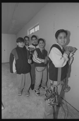 Coast Salish youths using power tools during gym construction [7 of 8 photographs]