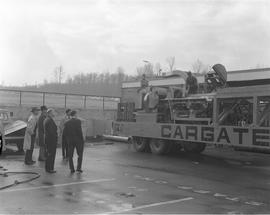 Forestry visit for Mr. Roper at BCIT on December 10, 1965; a group of men looking at a Barker Chi...