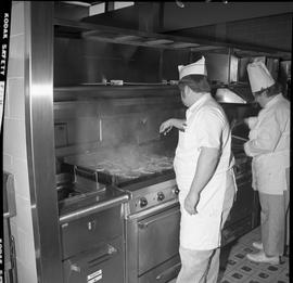 BC Vocational School Cook Training Course ; a student frying meat on a grill