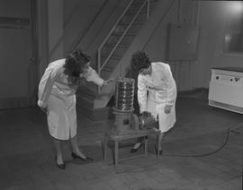 Food Processing Technology, 1966; two woman in a lab coats using food testing equipment