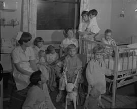 Nursing, 1967; three nurses having story hour with a group of children [2 of 2]