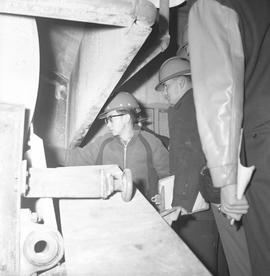 Forestry, Wood fiber BCIT tour, November 26, 1965; men wearing hard hats looking at machinery (br...