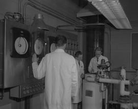Forest Products, 1966; three men in lab coats working in a forest products lab