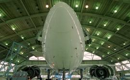 Front view of an airplane inside a hangar [3 of 4 photographs]