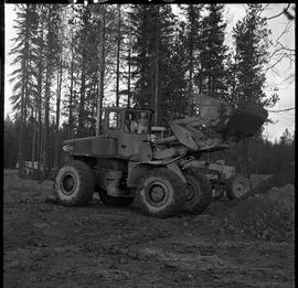 Heavy duty equipment operator, Nanaimo ; man operating a bulldozer carrying dirt
